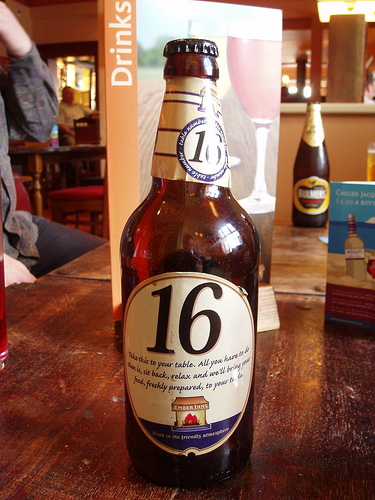 An Ember Inns bottle table marker