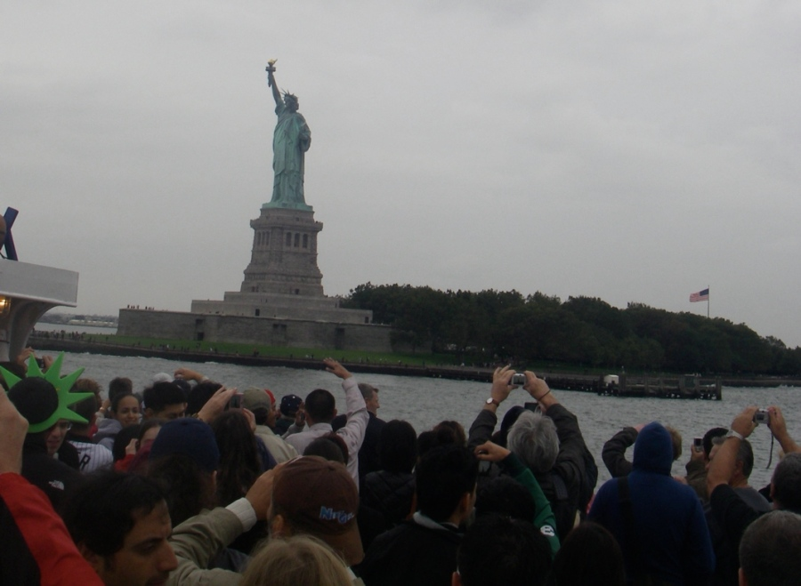 The Statue of Liberty and lots of hands