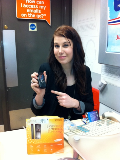 Adele from Phones 4U Nottingham Victoria branch - Complete with perfect sign above her head