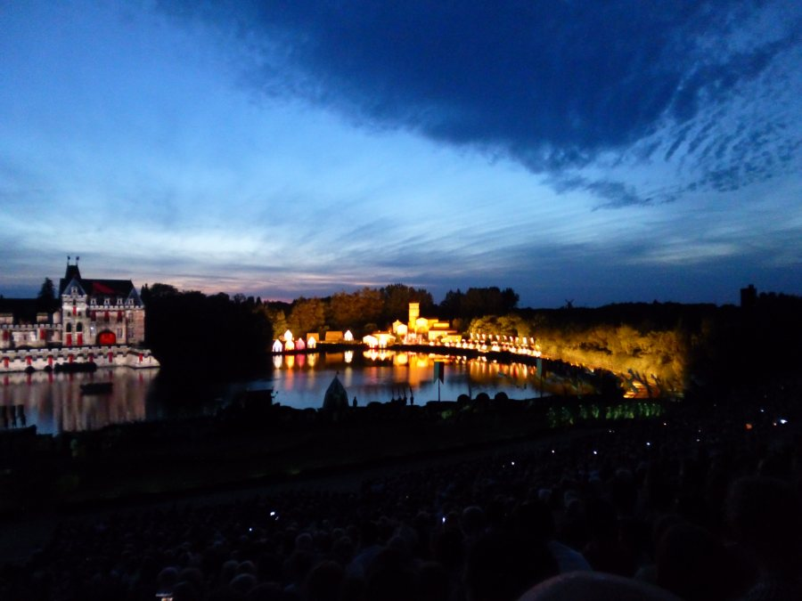 A huge village is lit up from nowhere in Cinescenie at Puy du Fou