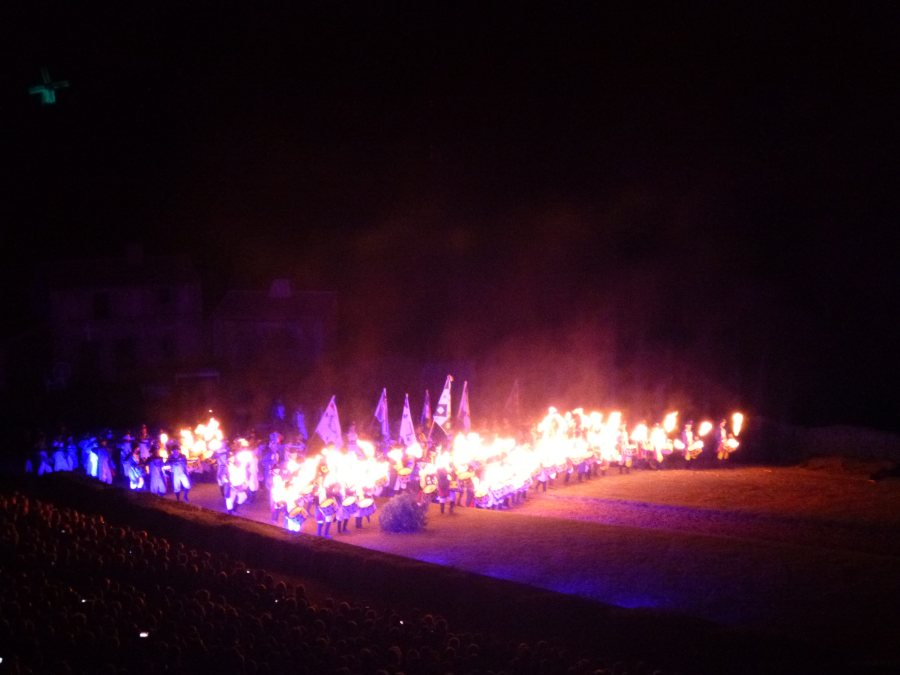 Drummers arrive with their drumsticks on fire at Cinescenie at Puy du Fou