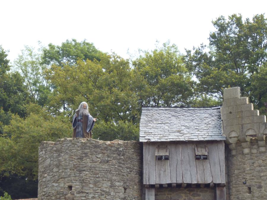 Merlin appears at the top of a castle at Puy du Fou in the Knights of the round table show