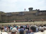 The horsemen jump on and off at full speed as they fly by at Puy du Fou